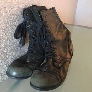 Extremely well worn Steve Madden combat boots